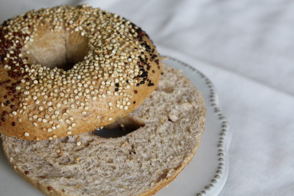 A bagel made with BeneGrain Sprouted Wheat flour and topped with quinoa.
