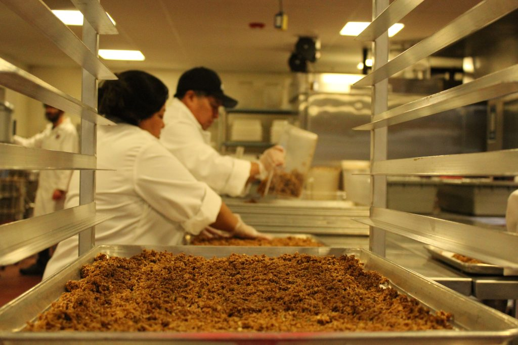 Staff at Boston's CommonWealth Kitchen work on HealthSense granola in their co-manufacturing space.