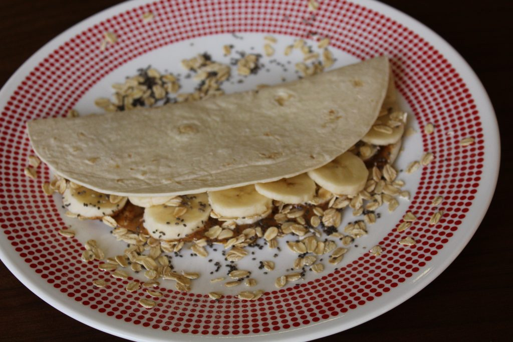 This Breakfast Quesadilla made on a HealthSense tortilla includes nut butter, banana, oats and chia seeds.