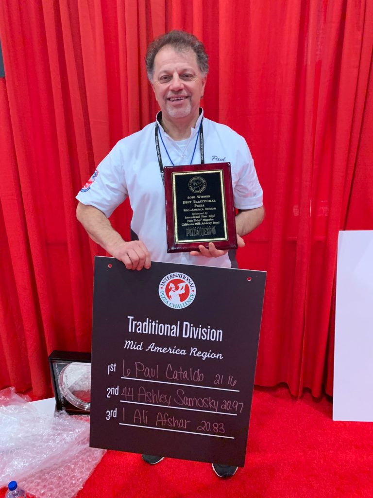 Paul Cataldo shows his plaque after finishing first in the Traditional Division of the International Pizza Challenge.